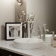 Transitional Powder Room by Capstone Custom Homes