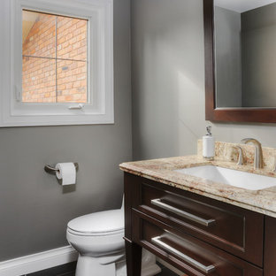 Photo of a medium sized traditional cloakroom in Toronto with a submerged sink, recessed-panel cabinets, granite worktops, grey walls, slate flooring and dark wood cabinets.