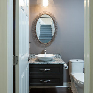 Inspiration for a small transitional dark wood floor powder room remodel in Detroit with recessed-panel cabinets, dark wood cabinets, a two-piece toilet, gray walls, a vessel sink, granite countertops and gray countertops