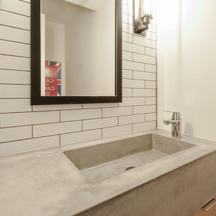 Design ideas for a small classic cloakroom in Toronto with flat-panel cabinets, light wood cabinets, a one-piece toilet, white tiles, metro tiles, white walls, slate flooring, an integrated sink, concrete worktops and grey floors.