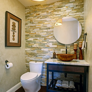 Design ideas for a small contemporary cloakroom in San Francisco with a vessel sink, freestanding cabinets, granite worktops, a one-piece toilet, multi-coloured tiles, stone tiles, beige walls and dark hardwood flooring.