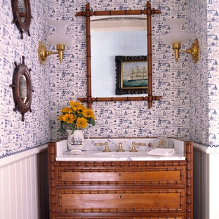 Small island style powder room photo in Miami with an undermount sink, furniture-like cabinets and medium tone wood cabinets