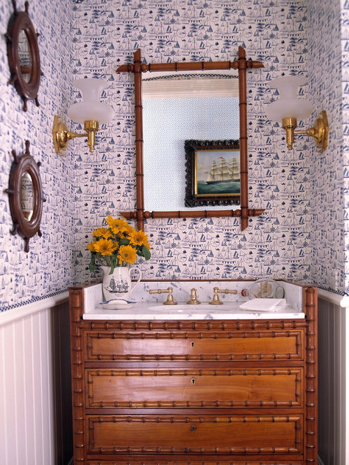 Small island style powder room photo in Miami with an undermount sink,  furniture-like