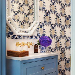 Inspiration for a tropical medium tone wood floor and brown floor powder room remodel in Boston with beaded inset cabinets, blue cabinets and engineered quartz countertops