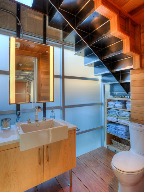inspiration for a contemporary powder room remodel in seattle with flat panel cabinets light - Bathroom Designs Under Stairs