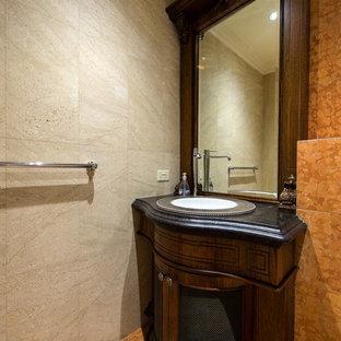 На фото: маленький туалет в стиле рустика с накладной раковиной, темными деревянными фасадами, столешницей из гранита, терракотовой плиткой и фасадами островного типа