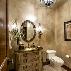 mediterranean powder room by Stotler Design Group