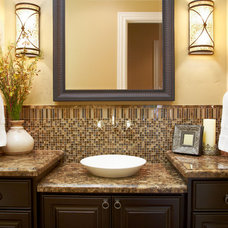 Mediterranean Powder Room by Fautt Homes