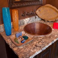 Mediterranean Powder Room by Jim Boles Custom Homes