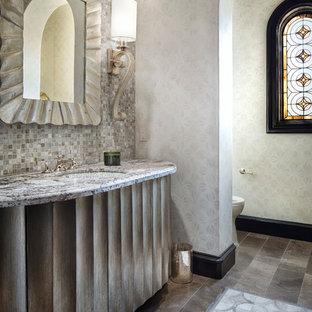 Идея дизайна: туалет в средиземноморском стиле с врезной раковиной, фасадами островного типа, плиткой мозаикой, серыми стенами и серой плиткой