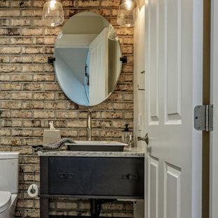 Пример оригинального дизайна: туалет среднего размера в стиле лофт с плоскими фасадами, черными фасадами, раздельным унитазом, паркетным полом среднего тона, накладной раковиной, столешницей из гранита, коричневым полом и серой столешницей