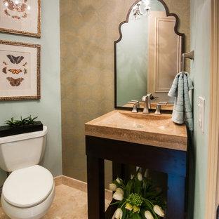 На фото: туалет в стиле современная классика с монолитной раковиной, раздельным унитазом, фасадами островного типа, темными деревянными фасадами и столешницей из травертина с