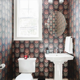 Small eclectic ceramic tile and black floor powder room photo in Atlanta with a two-piece toilet, multicolored walls and a pedestal sink