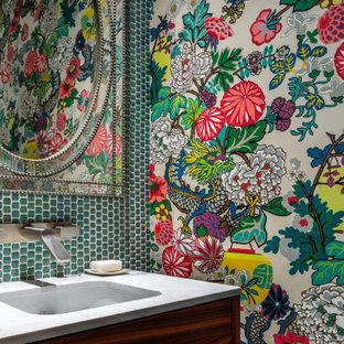 デンバーのコンテンポラリースタイルのおしゃれなトイレ・洗面所 (フラットパネル扉のキャビネット、濃色木目調キャビネット、ガラス板タイル、オーバーカウンターシンク、クオーツストーンの洗面台、白い洗面カウンター、造り付け洗面台、壁紙) の写真
