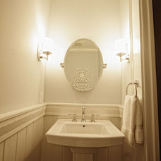 Traditional Powder Room by Level Team Contracting