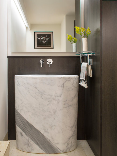 Example Of A Trendy Powder Room Design In Denver With An Integrated Sink