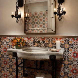 Photo of an expansive mediterranean cloakroom in Phoenix with grey tiles, multi-coloured tiles, red tiles, yellow tiles, mosaic tiles, beige walls, an integrated sink and beige floors.
