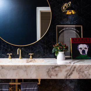 Inspiration for a traditional cloakroom in Los Angeles with black tiles, an integrated sink, marble worktops and multi-coloured worktops.