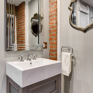 Powder room - mid-sized traditional powder room idea in Los Angeles with furniture-like cabinets, gray cabinets, gray walls and a vessel sink