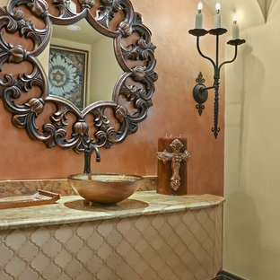 Inspiration for a mediterranean cloakroom in Austin with pink walls, a vessel sink and multi-coloured worktops.
