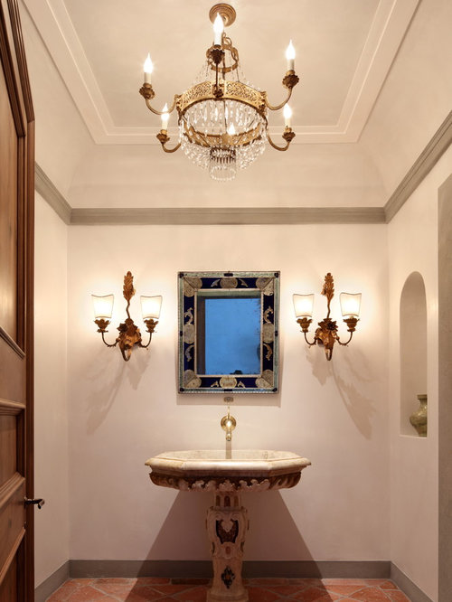 mediterranean terra cotta floor and orange floor powder room idea in los angeles with white - Powder Room Pedestal Sink