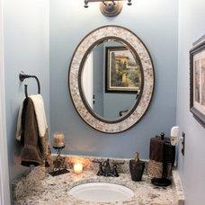 Traditional Powder Room by Essence Design Studios