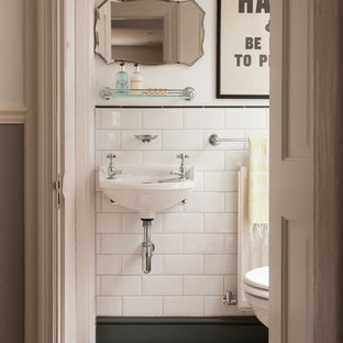 This Is An Example Of A Small Traditional Cloakroom In London With Wall Mounted