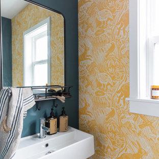 Свежая идея для дизайна: туалет в стиле ретро с желтыми стенами и подвесной раковиной - отличное фото интерьера