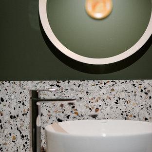 他の地域の小さいコンテンポラリースタイルのおしゃれなトイレ・洗面所 (落し込みパネル扉のキャビネット、グレーのキャビネット、白い壁、テラゾーの床、ベッセル式洗面器、ラミネートカウンター、マルチカラーの床、グレーの洗面カウンター、フローティング洗面台、一体型トイレ) の写真
