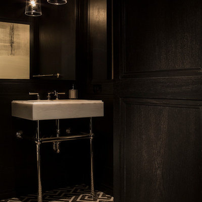 Powder room - mid-sized modern powder room idea in New York with a console sink
