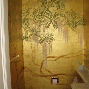 Ispirazione per un piccolo bagno di servizio etnico con top in marmo, WC monopezzo e pareti multicolore