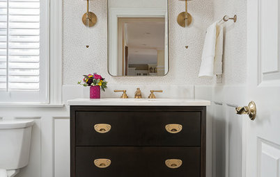 Botanical Blooms and Brass Wow in a Pretty Powder Room