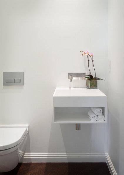 Contemporary Powder Room by Design Line Construction, Inc.