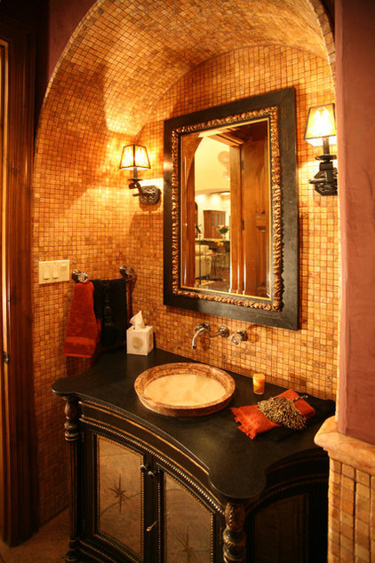 Mediterranean Powder Room by Alberto Jauregui Designs, Inc.