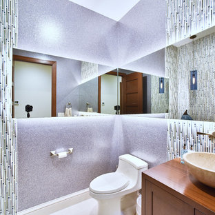 Photo of a medium sized contemporary cloakroom in Baltimore with shaker cabinets, white cabinets, a one-piece toilet, multi-coloured tiles, matchstick tiles, purple walls, marble flooring, a vessel sink, grey floors and wooden worktops.