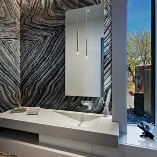 Medium sized contemporary cloakroom in Phoenix with white cabinets, stone slabs, concrete flooring, an integrated sink, concrete worktops, grey floors, flat-panel cabinets, multi-coloured tiles, multi-coloured walls, grey worktops and a one-piece toilet.