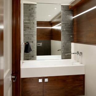 This is an example of a small contemporary cloakroom in Boston with flat-panel cabinets, medium wood cabinets, white walls, slate flooring, an integrated sink and engineered stone worktops.