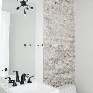 Immagine di un bagno di servizio contemporaneo con ante lisce, ante marroni, piastrelle bianche, pareti bianche, pavimento in terracotta, top in superficie solida, pavimento grigio e lavabo a bacinella