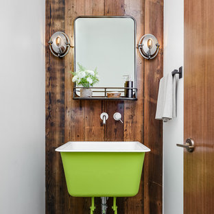 Design ideas for an eclectic powder room in San Francisco with brown walls, concrete floors, a vessel sink and grey floor.