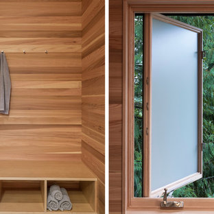 Photo of a contemporary cloakroom in Portland with flat-panel cabinets, medium wood cabinets and slate flooring.
