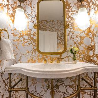 Imagen de aseo contemporáneo con paredes amarillas y lavabo tipo consola