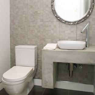 Immagine di un piccolo bagno di servizio design con top in cemento