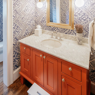 Arts and crafts dark wood floor powder room photo in Houston with red cabinets, blue walls, an undermount sink, gray countertops and shaker cabinets