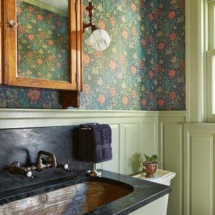На фото: туалеты в классическом стиле с врезной раковиной, фасадами с выступающей филенкой, зелеными фасадами, столешницей из талькохлорита и разноцветными стенами