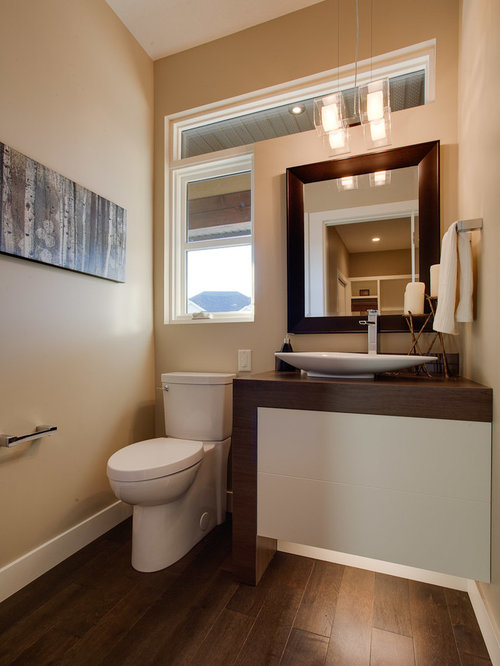 example of a trendy powder room design with a vessel sink