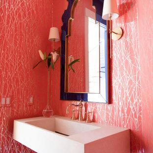 На фото: туалет в современном стиле с красными стенами, подвесной раковиной и обоями на стенах с
