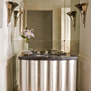 Ispirazione per un bagno di servizio chic con piastrelle a specchio