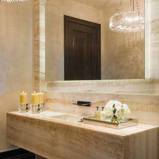 Powder room - contemporary marble tile powder room idea in Denver with an undermount sink and marble countertops