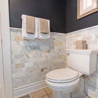 Medium sized classic cloakroom in Chicago with a two-piece toilet, multi-coloured tiles, marble tiles, grey walls, ceramic flooring, a vessel sink, solid surface worktops and brown floors.