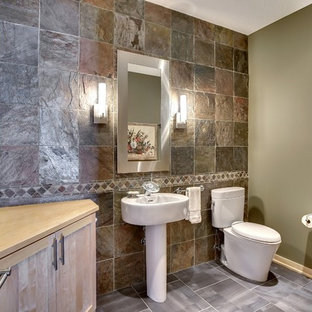 Modern cloakroom in Minneapolis with shaker cabinets, light wood cabinets, a two-piece toilet, multi-coloured tiles, multi-coloured walls, ceramic flooring, a pedestal sink, wooden worktops and slate tiles.